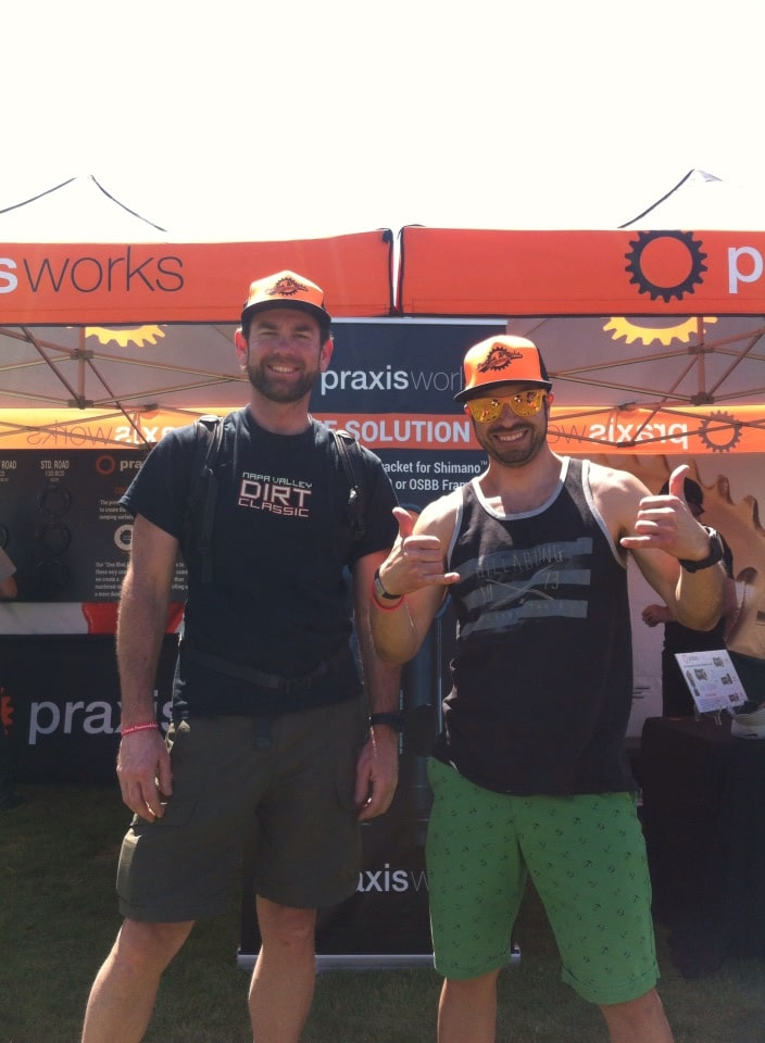 Praxis riders stoked on their booth hats.